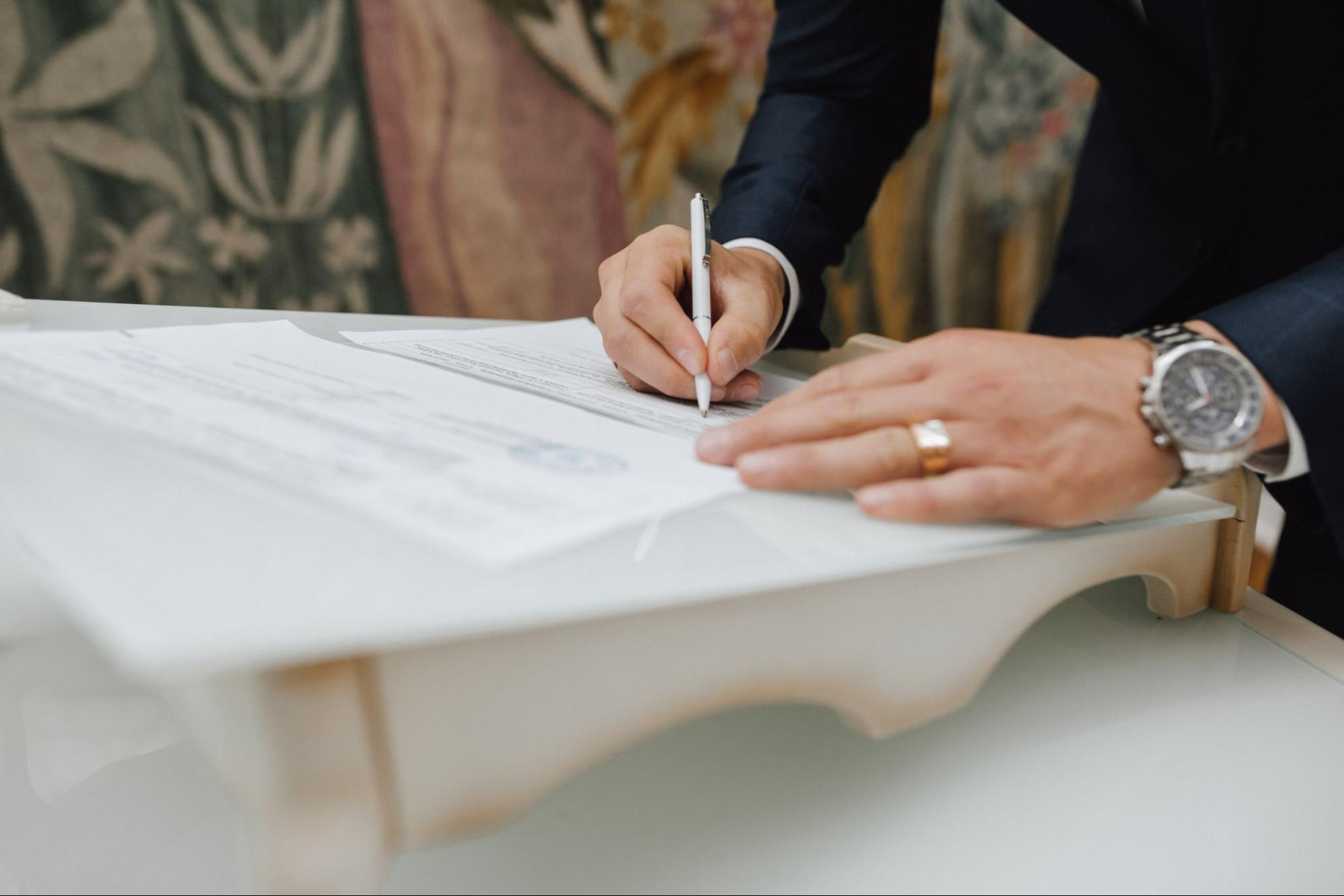 person-signing-a-property-registration-document